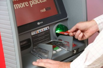 Man inserting card into a rediATM